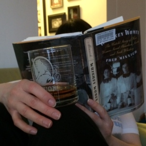 A photo of the blogger reading Fred Minnick's WHISKEY WOMEN with a dram of whisky in hand