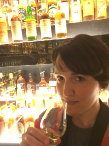 A photo of the author sipping whisky while admiring The Diageo Claive Vidiz Collection in Edinburgh.